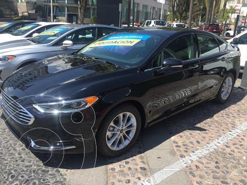 Ford Fusion SEL Hibrido usado (2020) color Negro financiado en mensualidades(enganche $147,499)