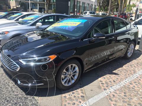 Ford Fusion SE LUX Hibrido usado (2020) color Negro precio $595,000