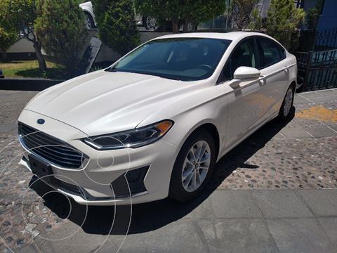 Ford Fusion SEL Hibrido usado (2020) color Blanco Platinado financiado en mensualidades(enganche $147,499)