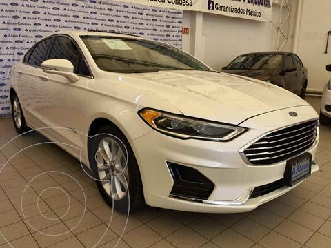 Ford Fusion SE LUX Hibrido usado (2019) color Blanco precio $413,600