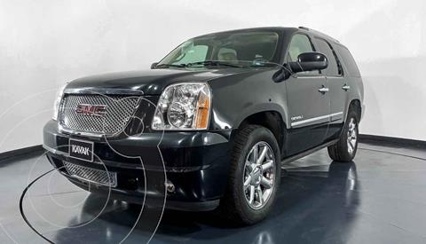 GMC Yukon Denali usado (2013) color Beige precio $327,999