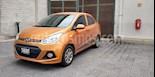 Foto venta Auto usado Hyundai Grand i10 GLS (2017) color Naranja precio $165,000