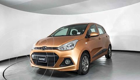 Hyundai Grand i10 Version usado (2015) color Naranja precio $129,999