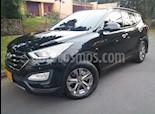Foto venta Carro usado Hyundai Santa Fe 2.4 4x2 7 Pas. (2016) color Negro Ebony precio $84.900.000