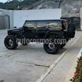 Foto venta carro usado Jeep Wrangler Auto. 4x4 (2015) color Negro precio u$s75.000