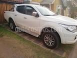 Foto venta Auto usado Mitsubishi L-200 2.4L TD Dakar 4X4 High Power (2018) color Blanco precio $19.500.000