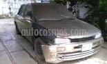 Foto venta carro usado Mitsubishi Lancer GLXi Auto. (1998) color Bronce precio u$s600