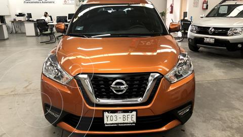 Nissan Kicks Exclusive Aut usado (2020) color Naranja Metalico financiado en mensualidades(enganche $91,820 mensualidades desde $7,752)