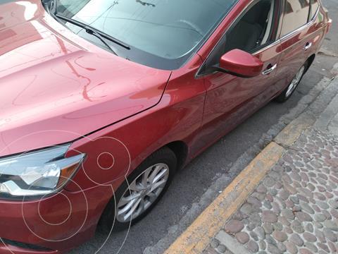 Nissan Sentra Sense usado (2017) color Rojo Burdeos precio $178,000