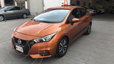 Nissan Versa Advance usado (2020) color Naranja financiado en mensualidades(enganche $68,419 mensualidades desde $5,534)