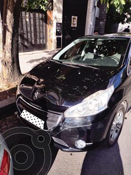 Peugeot 208 Feline 1.6  usado (2014) color Negro precio $1.100.000