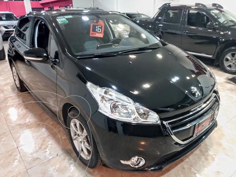 Peugeot 208 Allure 1.5 NAV usado (2016) color Negro financiado en cuotas(anticipo $800.000 cuotas desde $19.000)