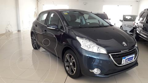 Peugeot 208 Feline 1.6 usado (2016) color Negro Perla financiado en cuotas(anticipo $850.000)