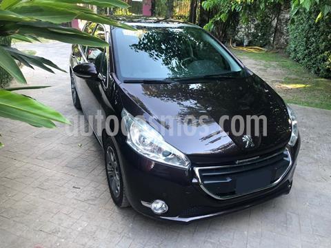 foto Peugeot 208 Feline 1.6 Pack Cuir usado (2014) color Rouge Noir precio $1.085.000