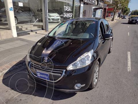 Peugeot 208 Feline 1.6 Pack Cuir usado (2014) color Negro precio $1.040.000