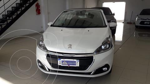 Peugeot 208 Allure 1.6 usado (2017) color Blanco Banquise financiado en cuotas(anticipo $990.000)