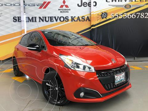 Peugeot 208 1.6L Feline usado (2017) color Naranja precio $200,000