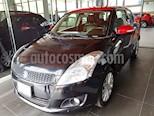 Foto venta Auto usado Suzuki Swift GLX Aut (2013) color Negro precio $130,000