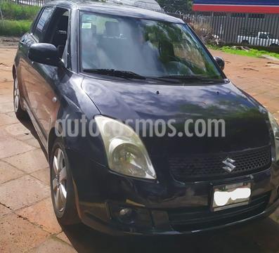 foto Suzuki Swift 1.4L usado (2011) color Negro precio $98,000