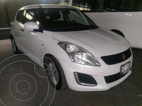 Suzuki Swift GA usado (2015) color Blanco financiado en mensualidades(enganche $34,524 mensualidades desde $4,507)