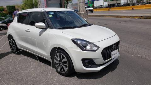 Suzuki Swift 5 pts. HB GLX, L4, 1.2l, TM5, a/ac. Aut., GPS, f usado (2018) color Blanco precio $225,000