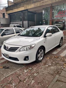 Toyota Corolla 1.8 XEi usado (2013) color Blanco financiado en cuotas(anticipo $840.000)