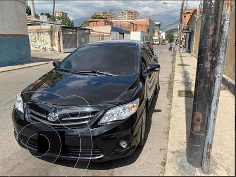Toyota Corolla 1.8L XLi Aut usado (2014) color Negro precio $30.000.000
