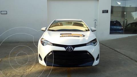 Toyota Corolla LE 1.8L usado (2018) color Blanco precio $245,000