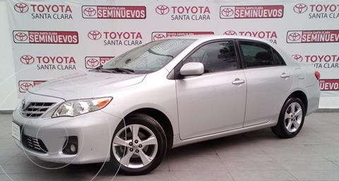 Toyota Corolla XLE 1.8L usado (2013) color Plata Dorado precio $165,000