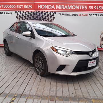 Toyota Corolla Base usado (2014) color Plata Metalico financiado en mensualidades(enganche $70,000 mensualidades desde $5,380)