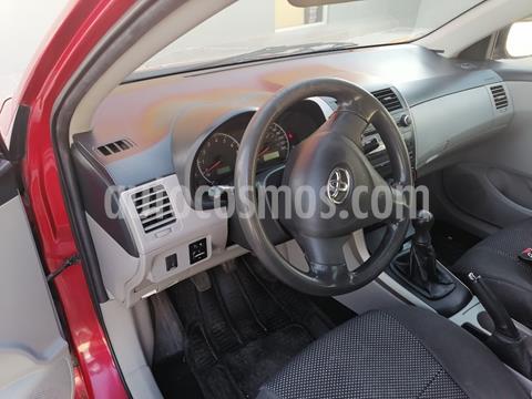 Toyota Corolla XLE 1.8L SR usado (2011) color Rojo precio $125,000