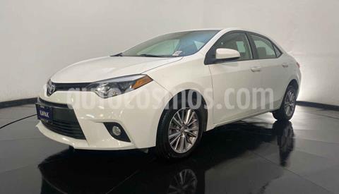 Toyota Corolla LE 1.8L Aut usado (2014) color Blanco precio $182,999