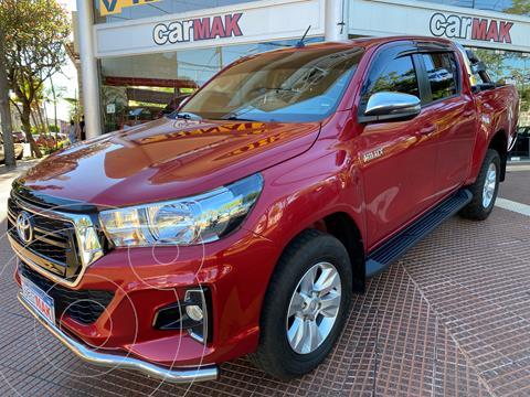 Toyota Hilux 2.8 4x2 SRV TDi DC Aut usado (2019) color Rojo financiado en cuotas(anticipo $3.300.000)