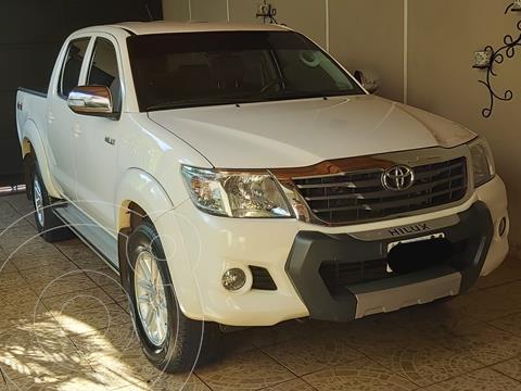 Toyota Hilux 2.7 4x4 SRV DC Cuero usado (2013) color Blanco precio $2.350.000